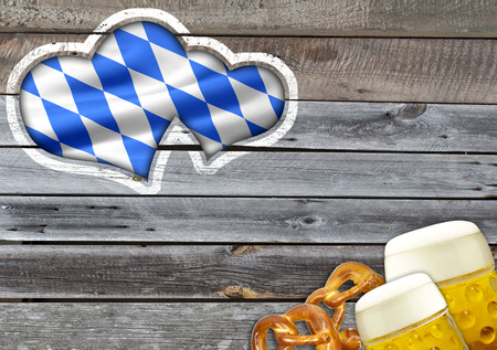 Traditional german bavarian festival Oktoberfest with pretzels, beer and gingerbread heart