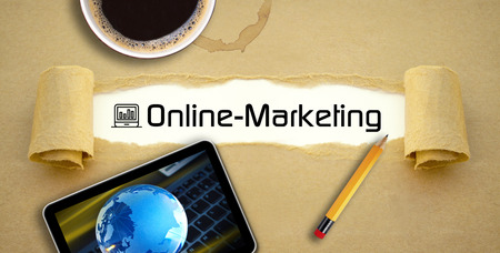 Desktop with a cup of coffee, tablet or smartphone and online marketing