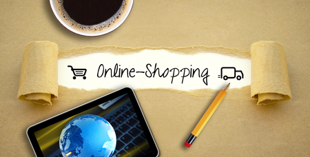 Desktop with a cup of coffee using tablet or smartphone using online shopping