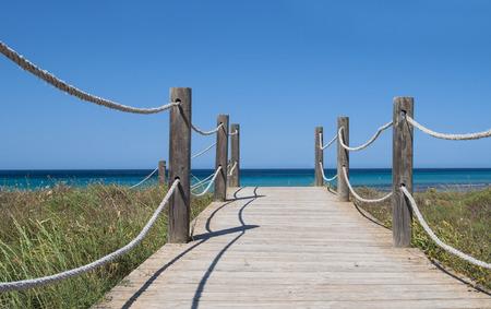 Wooden footpath to the mediterranean sea in spain