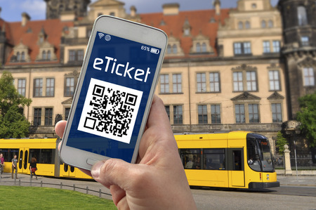 Hand with smartphone showing e ticket