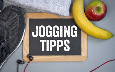 Chalkboard with sport shoes, towel and fruits Piloxing