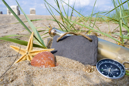 Message in a bottle with wood, chalkboard and maritime decoration Stock Photo