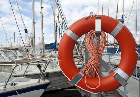 Lifebelt Lifebuoy in the marina or yacht belt