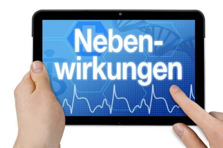 Tablet computer with the german word for side effects - side effects Archivio Fotografico