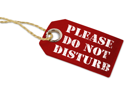 Wooden hang tag with please do not disturb Фото со стока