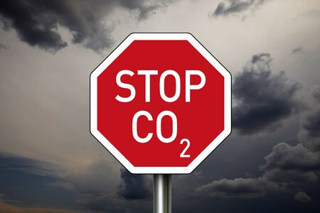 Stop sign with dark clouds and STOP CO2