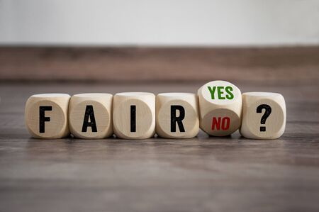 Cubes and dice with fair yes or no on wooden background Foto de archivo