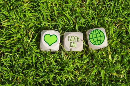 Cubes and dice with Earth Day with green electricity icons