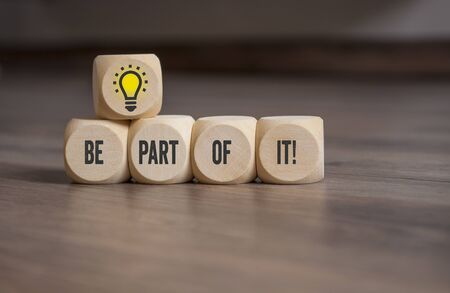Cubes and dice with light bulb and words on it on wooden background