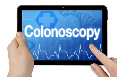 Tablet with medical touchscreen and term colonoscopy isolated Stock Photo