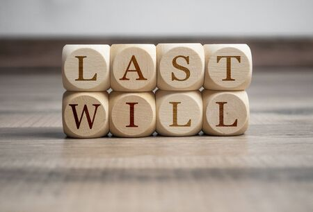 Cubes and dice with words last will on wooden background Stock Photo