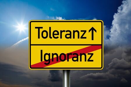 Road or traffic sign with german words for tolerance and ignorance