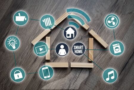 Cubes and dice with smartphone and network smart home smarthome Archivio Fotografico