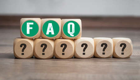 Cubes and dice with acronym faq frequently asked questions Archivio Fotografico