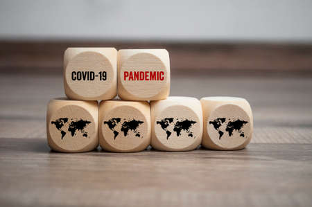 Cubes and dice with covid-19 corona virus on wooden background Archivio Fotografico