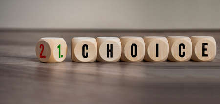 Cubes, dice or blocks with first and second choice and the german translation first choice and second choice on wooden background