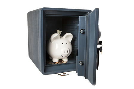 safe and sound: Picture of Isolated Fireproof Safe On White Background With Coins, Money and Happy Smiling Ceramic Piggy Bank Safe and Sound