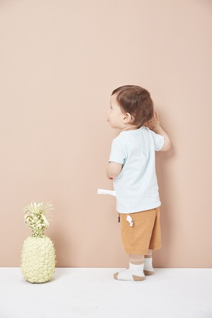 A one and a half year old boy learned to walk on the wall.