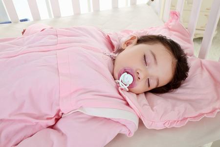 the sweet little girl was asleep in the pink sleeping bag