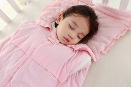 the sweet little girl was asleep in the pink sleeping bag