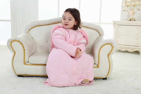 a child on a chair in a nice dress