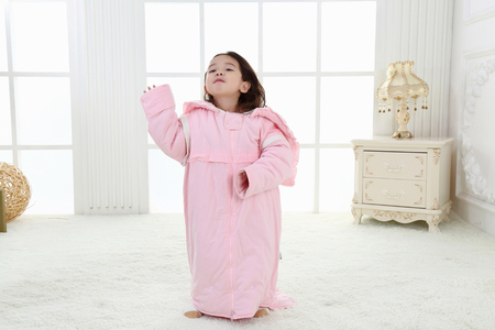 the sweet little girl was playing in her bedroom in pink pajamas Stock fotó