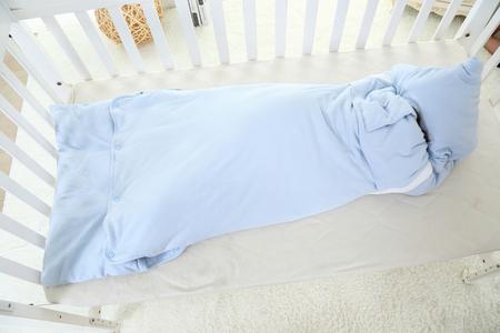 beautiful little girl lying in bed in her sleeping bag Stock fotó