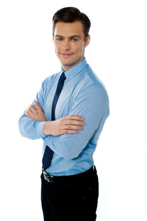 Executive standing isolated with folded hands and smiling at camera Stock Photo - 13217227