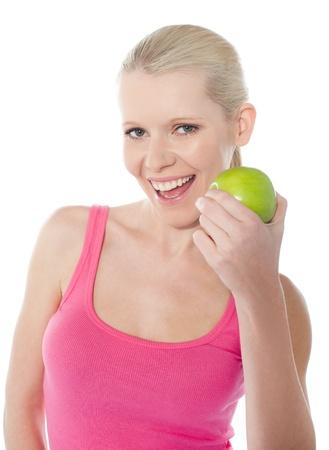 Pretty caucasian girl eating an apple photo