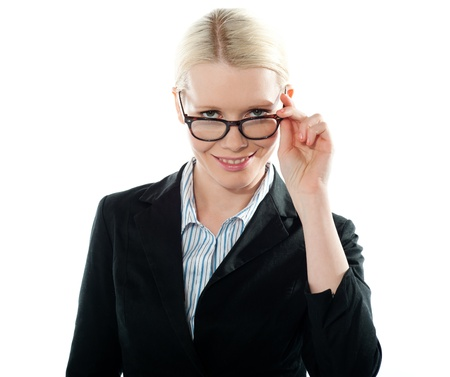 Businesswoman holding her glasses and taking a closer look from within Stock Photo - 13217188