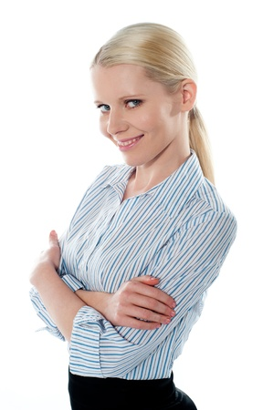 Saleswoman posing in style, arms-folded  Smiling at camera photo
