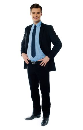 spokesperson: Portrait of a stylish businessman posing with hands on his waist Stock Photo
