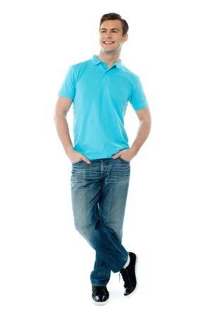 casuals: Full-body pose of smiling man posing in casuals with crossed legs