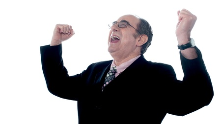 Successful old businessman shouting in excitement with arms up Stock Photo - 13217105