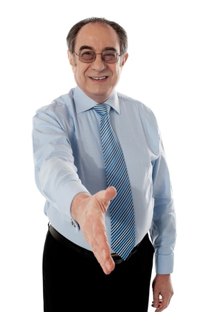 Businessman offering handshake to you, studio shot Stock Photo - 13217298