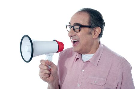Old person shouting into a big speaker on white background Stock Photo - 13217336