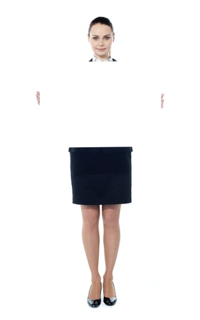 Woman showing billboard banner. White and blank with copyspace Stock Photo - 13217358