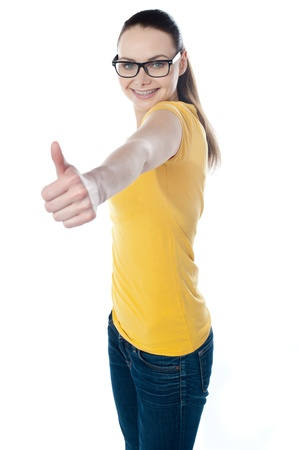 Glamourous teenager gesturing thumbs-up isolated on white Stock Photo - 13217396