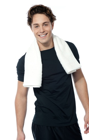Handsome muscular man with towel around his neck over white background Stock Photo - 13217456