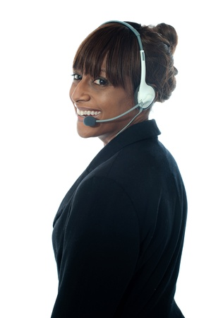 Portrait of executive female in headsets isoalted over white photo
