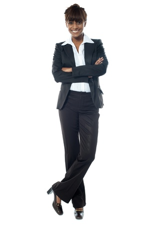 Young beautiful businesslady posing with legs crossed against white background Stock Photo - 13217420