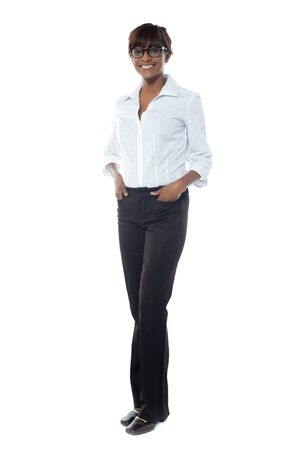 Gorgeous afrian businesswoman posing hands in pocket, full-length shot photo