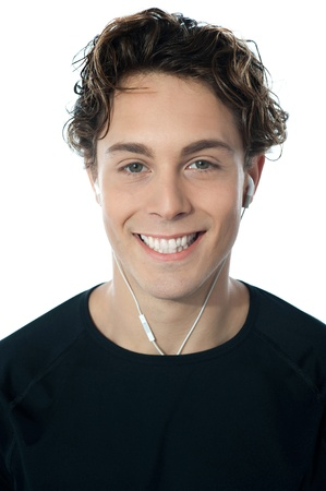 Young handsome guy listening music, closeup portrait photo
