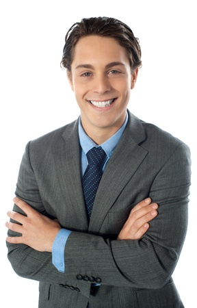 Handsome young man in business suit posing with folded arms Stock Photo - 13217511