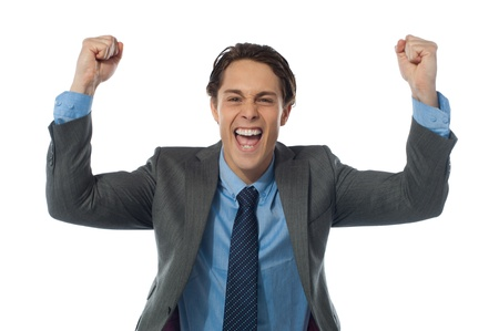 joyfully: Excited businessman rasing his arms and cheering joyfully  Isolated on white