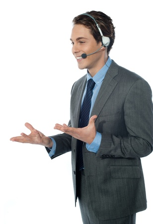 A customer support operator with a headset isolated on white Stock Photo - 13217506