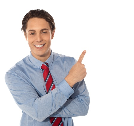 Business male pointing upwards and smiling at camera photo
