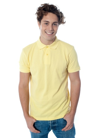 Portrait of a stylish young man standing with hands in pockets over white background Stock Photo - 13217469
