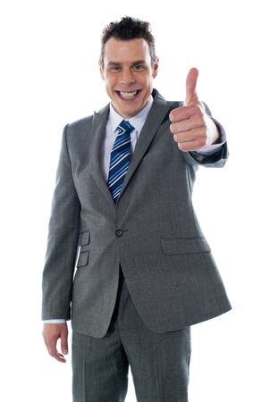 Businessman with thumbs-up isolated over white photo